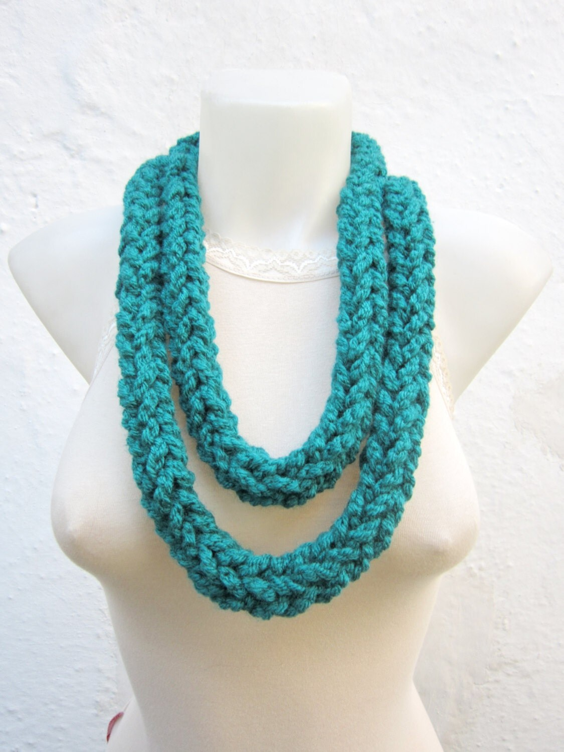 This tutorial shows you how to finger crochet a chain stitch and double crochet stitches. This gives you a solid foundation for learning other basic crochet stitches. The tutorial also covers some tips to help you master this technique. Yarn Chain Scarf.