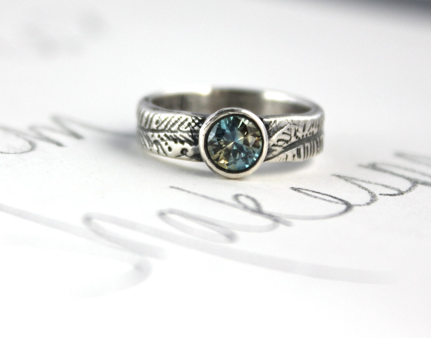 teal blue green Montana sapphire engagement ring by peacesofindigo