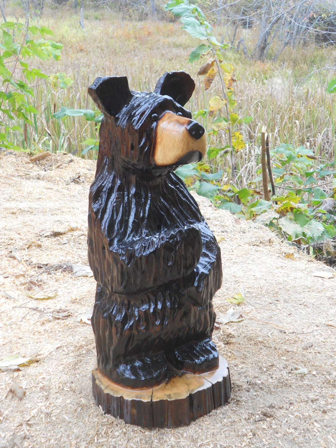 Original chainsaw carved wood black bear hand by alwayscarving