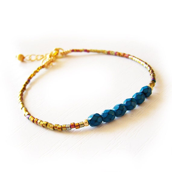 Friendship Bracelet with Faceted Blue Beads and Dark Gold Delica Glass Beads - DicopeJewelry