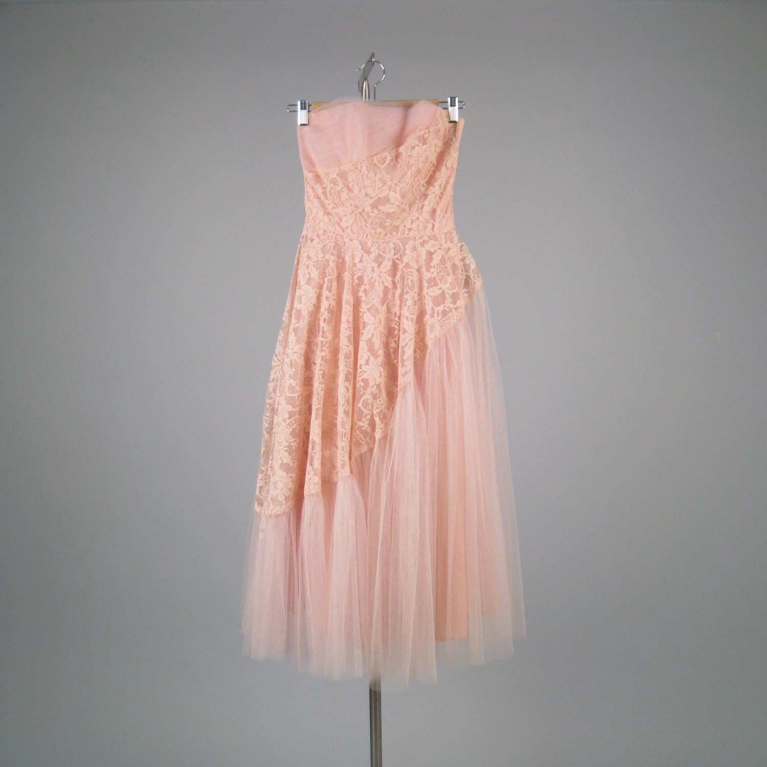 Vintage 1950s bubble gum pink strapless dress