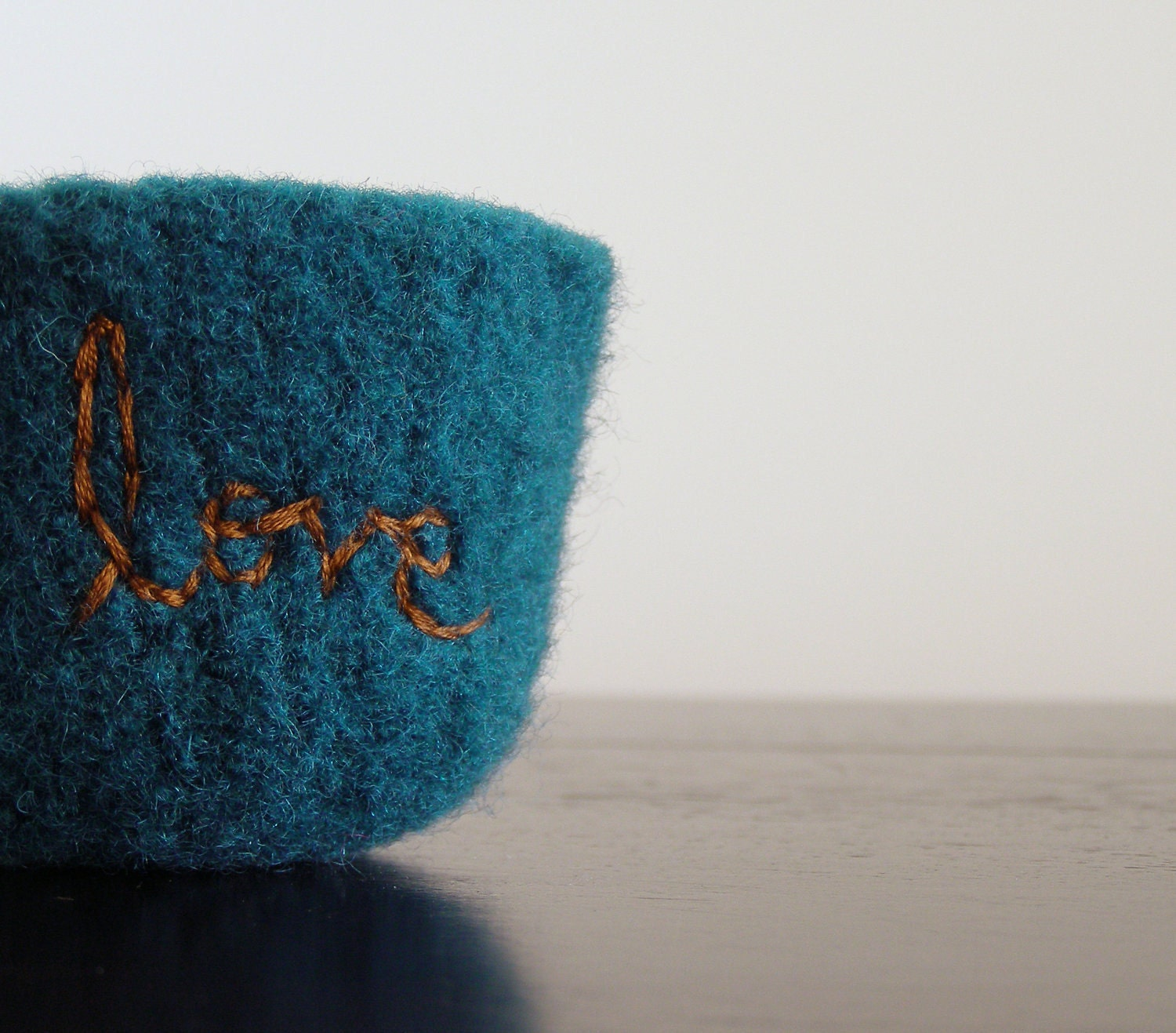 fuzzy felted dark teal wool bowl with the word love embroidered in brown - theFelterie