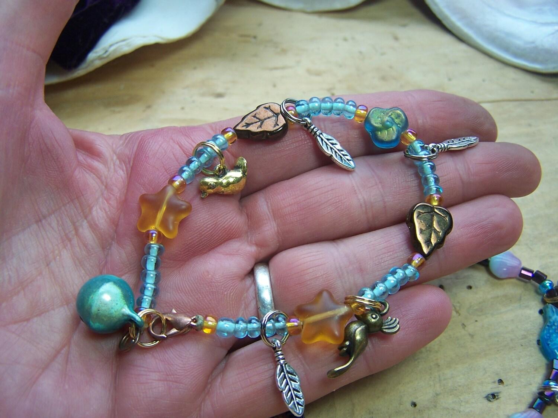 charm bracelet  Definition of charm bracelet in English