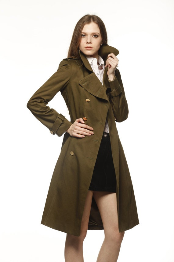 Wind and water resistant classic trench coat with double button front, collar, tie waist and pockets, Imported. Wind and water resistant classic trench coat with double button front, collar, tie waist and pockets, Imported. Somewhat Large. Loose but would not size down. Large. Recommend sizing down 1 size. Very Large. Recommend sizing down.