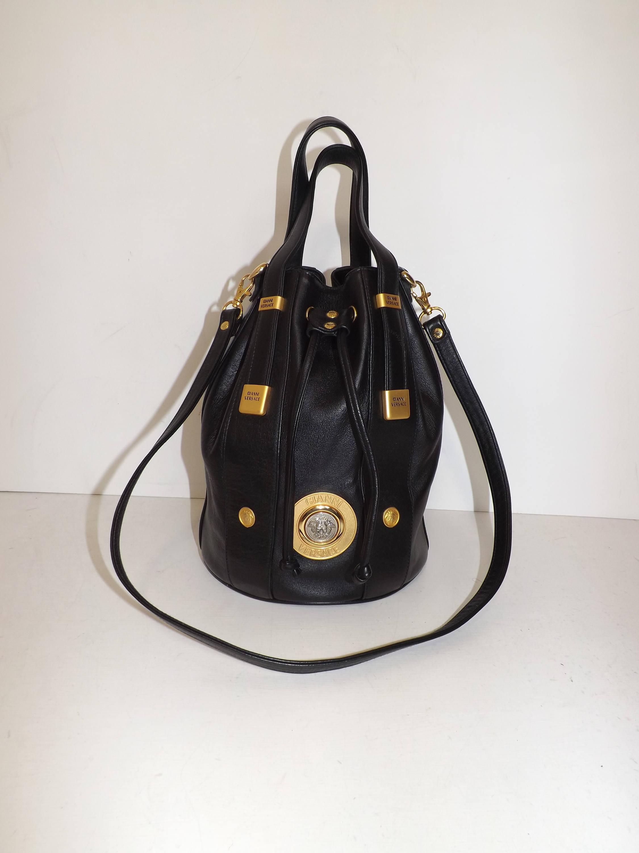 Vintage 1980s Gianni Versace black leather bucket drawstring handbag or shoulder bag with Medusa logo