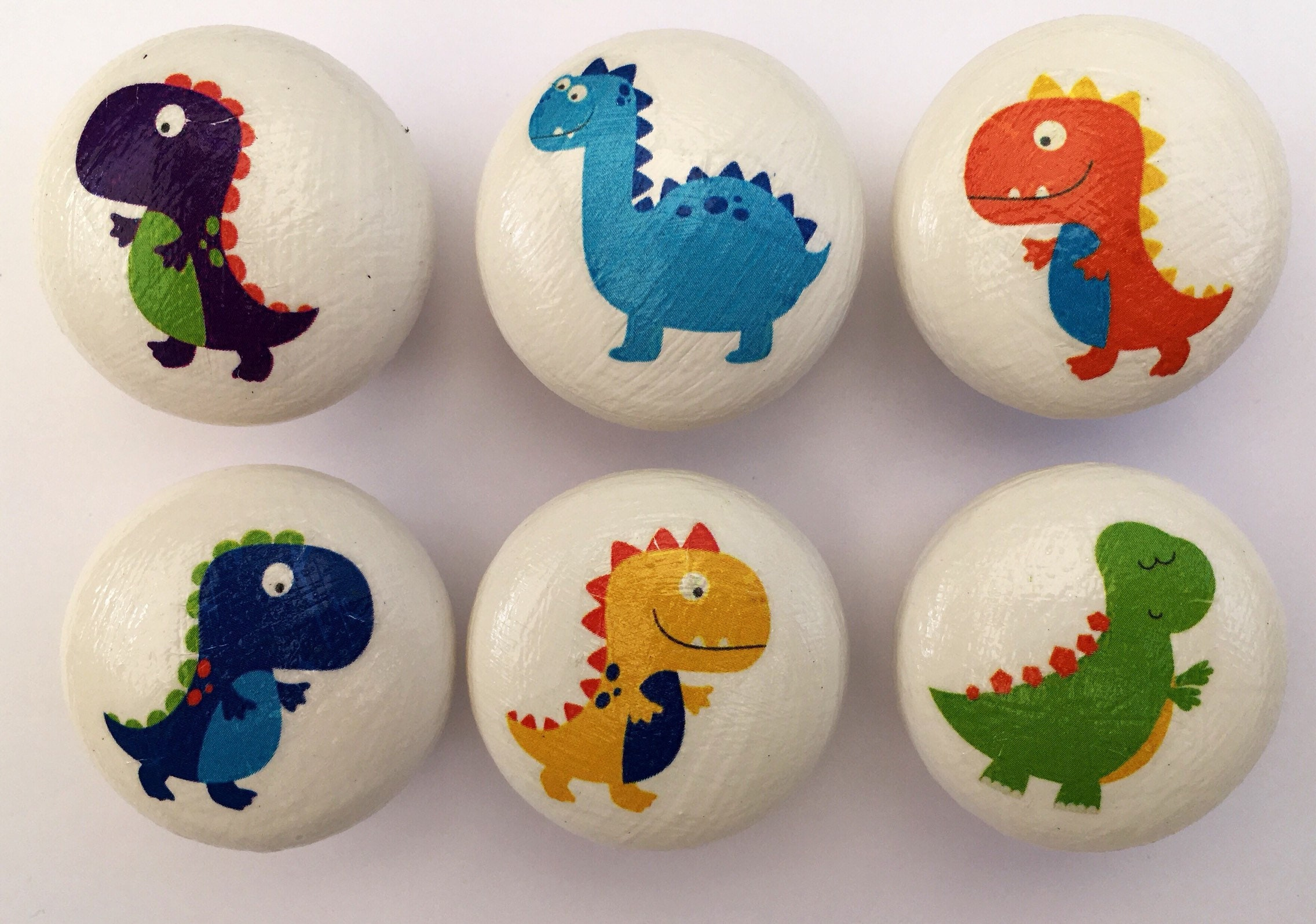 Wooden handmade dinosaur drawer knobs. Kids/nursery drawer knobs in assorted dinosaur designs(41mm) with screws. Dinosaur decor drawer pulls