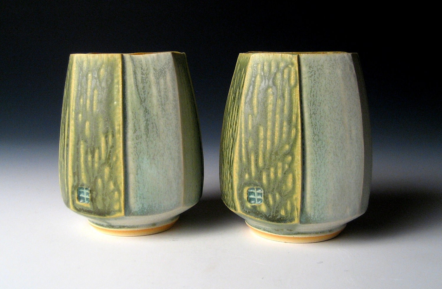 Pair of Squared and Carved Cups
