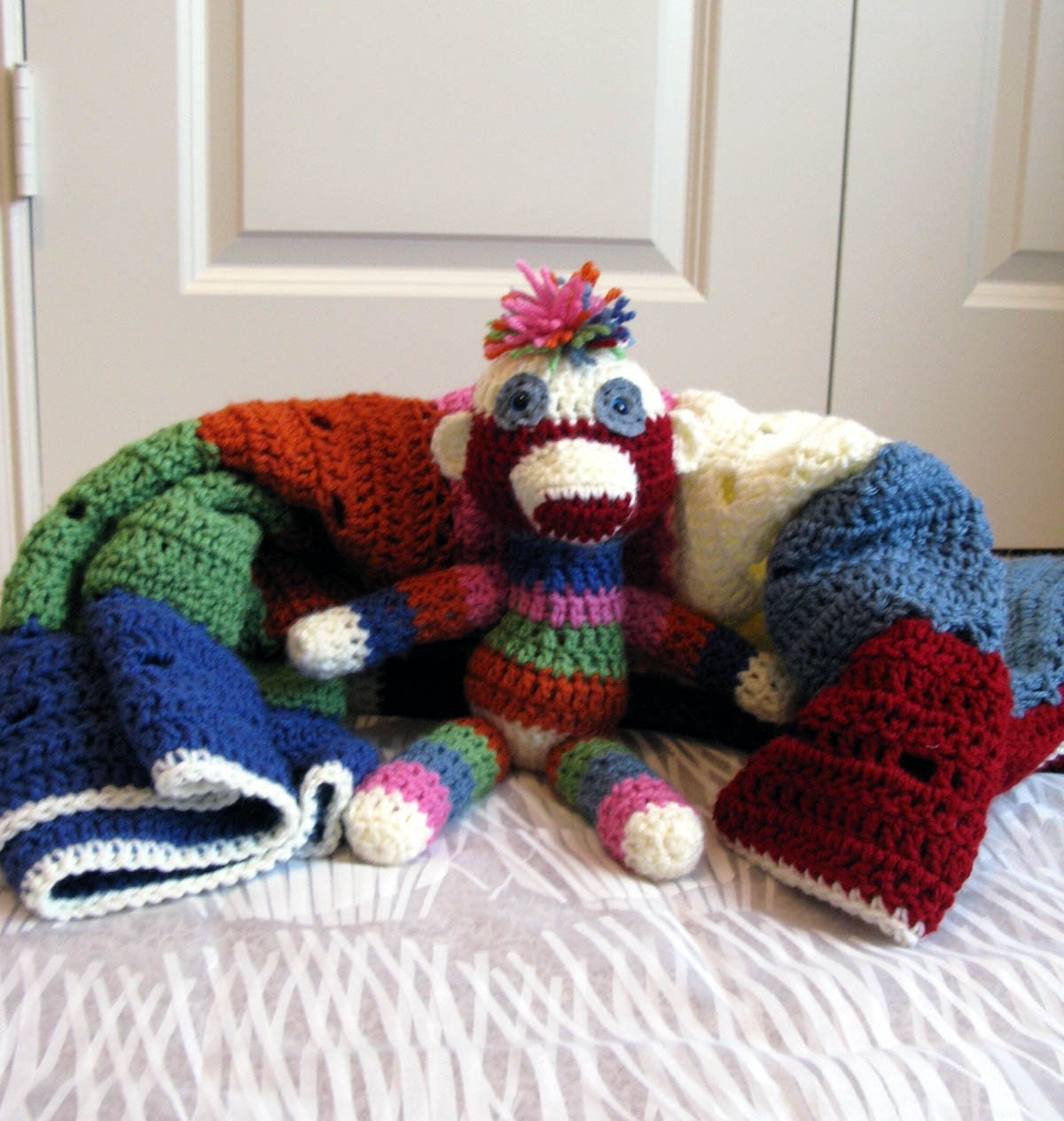 Crochet baby blanket with sock monkey by TheStrumpetsTentacle