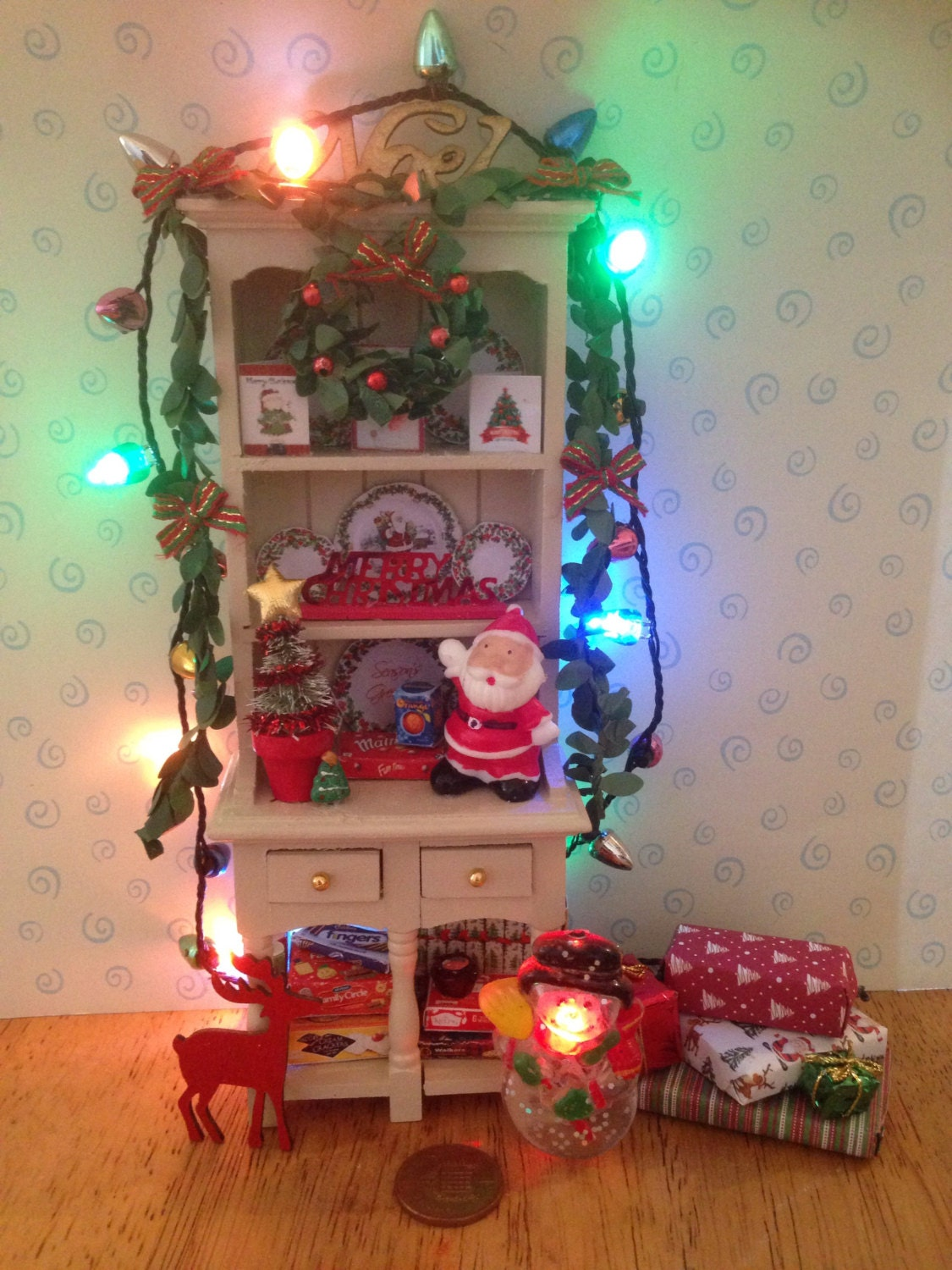 Reduced to clear Dolls house ivory painted dresser unit all decorated for christmas with removable working lights flashing snowman and all