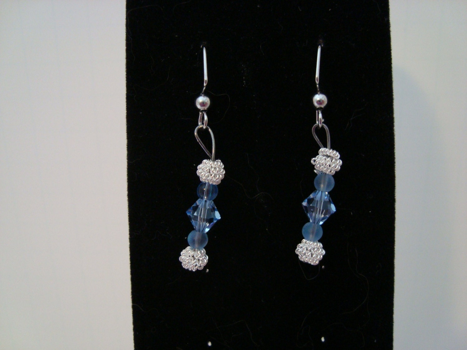 Silver and blue dangle earrings
