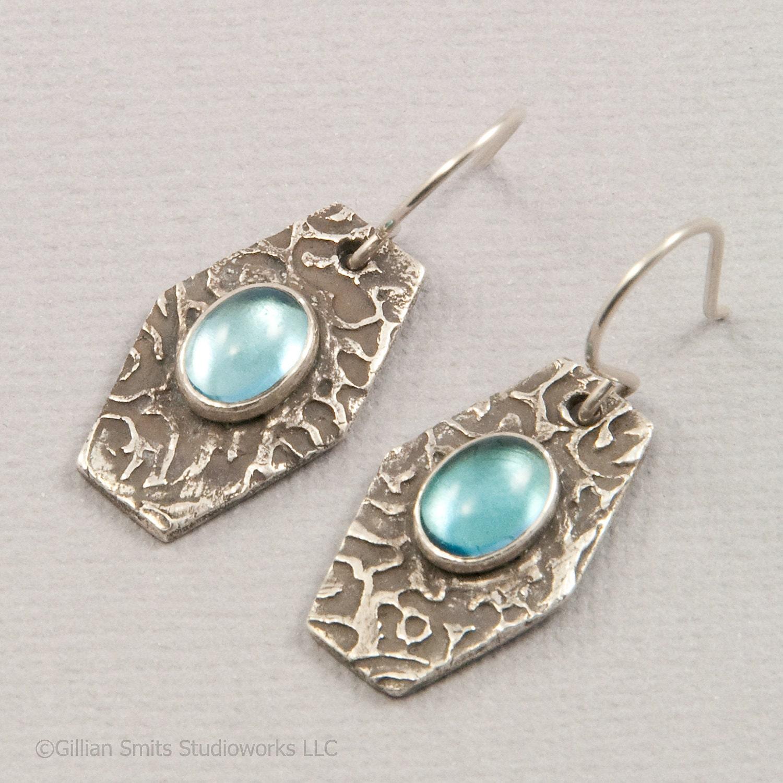 Precious blue topaz earrings in