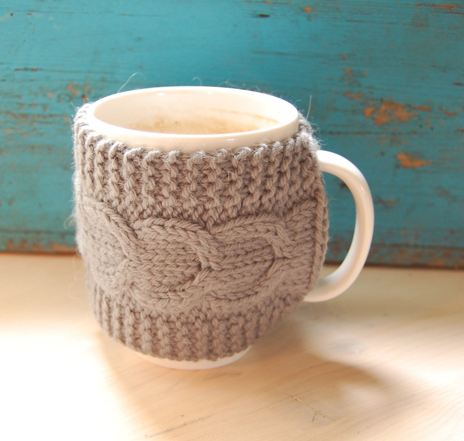 Knit coffee mug cozy with cable pattern, hand knitted, grey