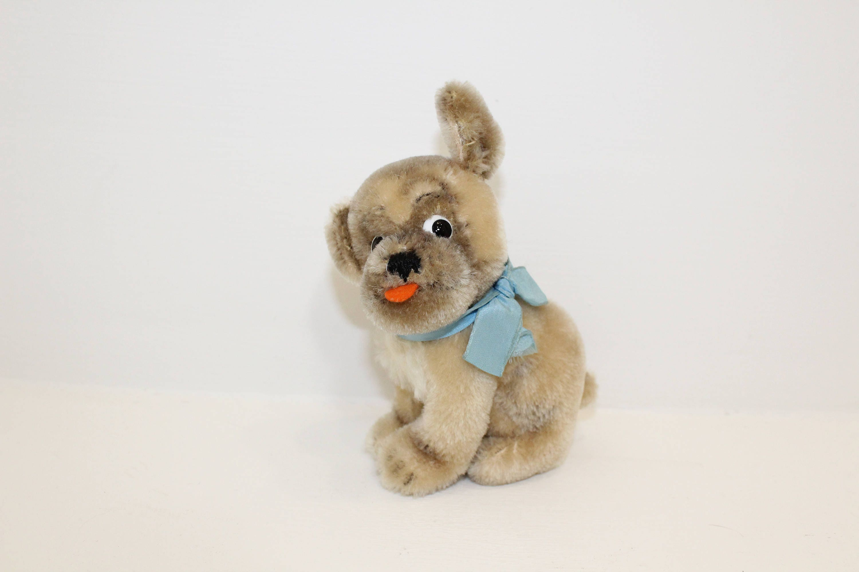 Vintage 1960s Steiff dog pug Mopsy mohair straw filled with button in ear and original blue ribbon bow