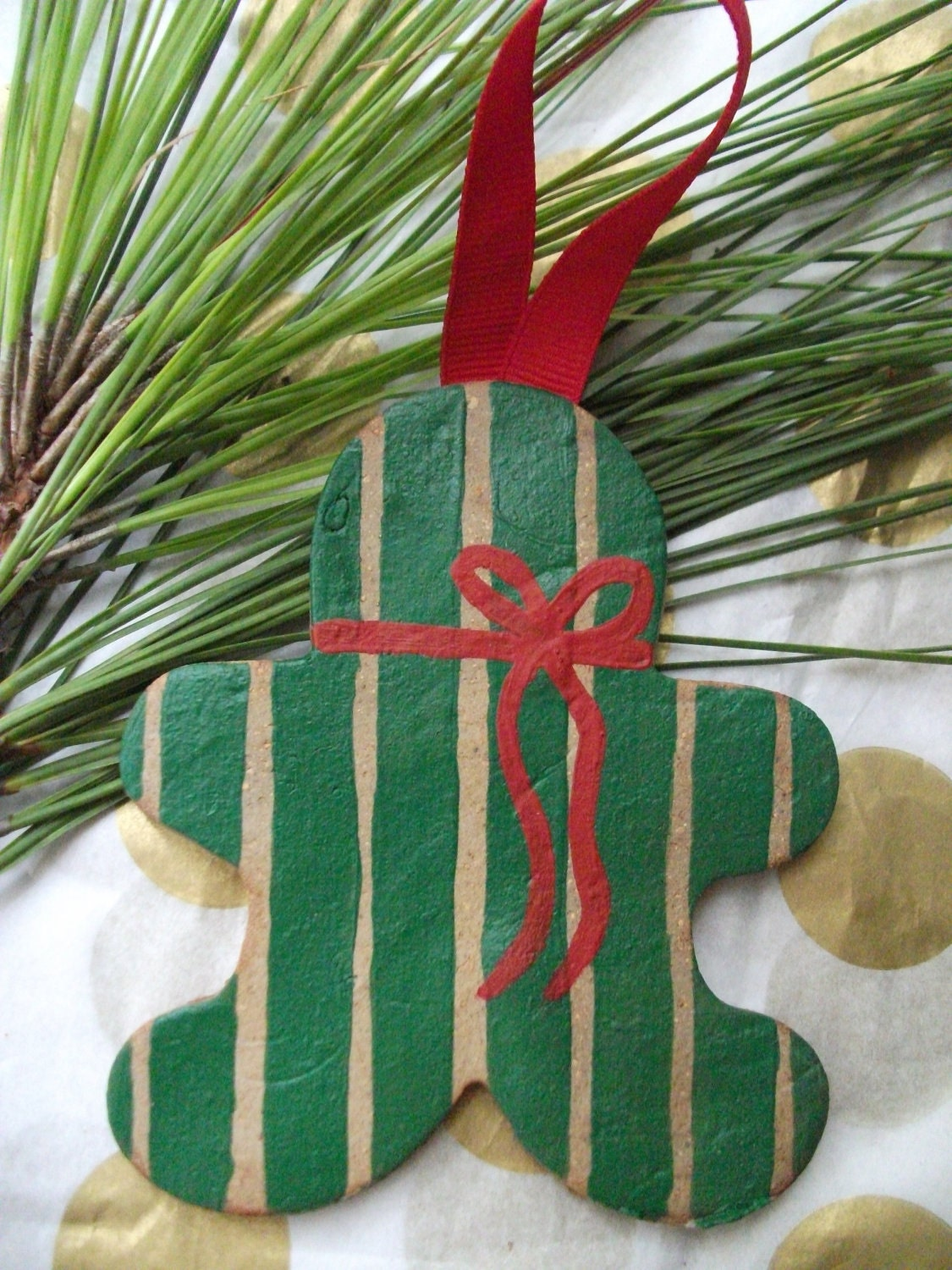 Hand painted gingerbread man Christmas ornament with green stripes and red bow - BetweenThePines