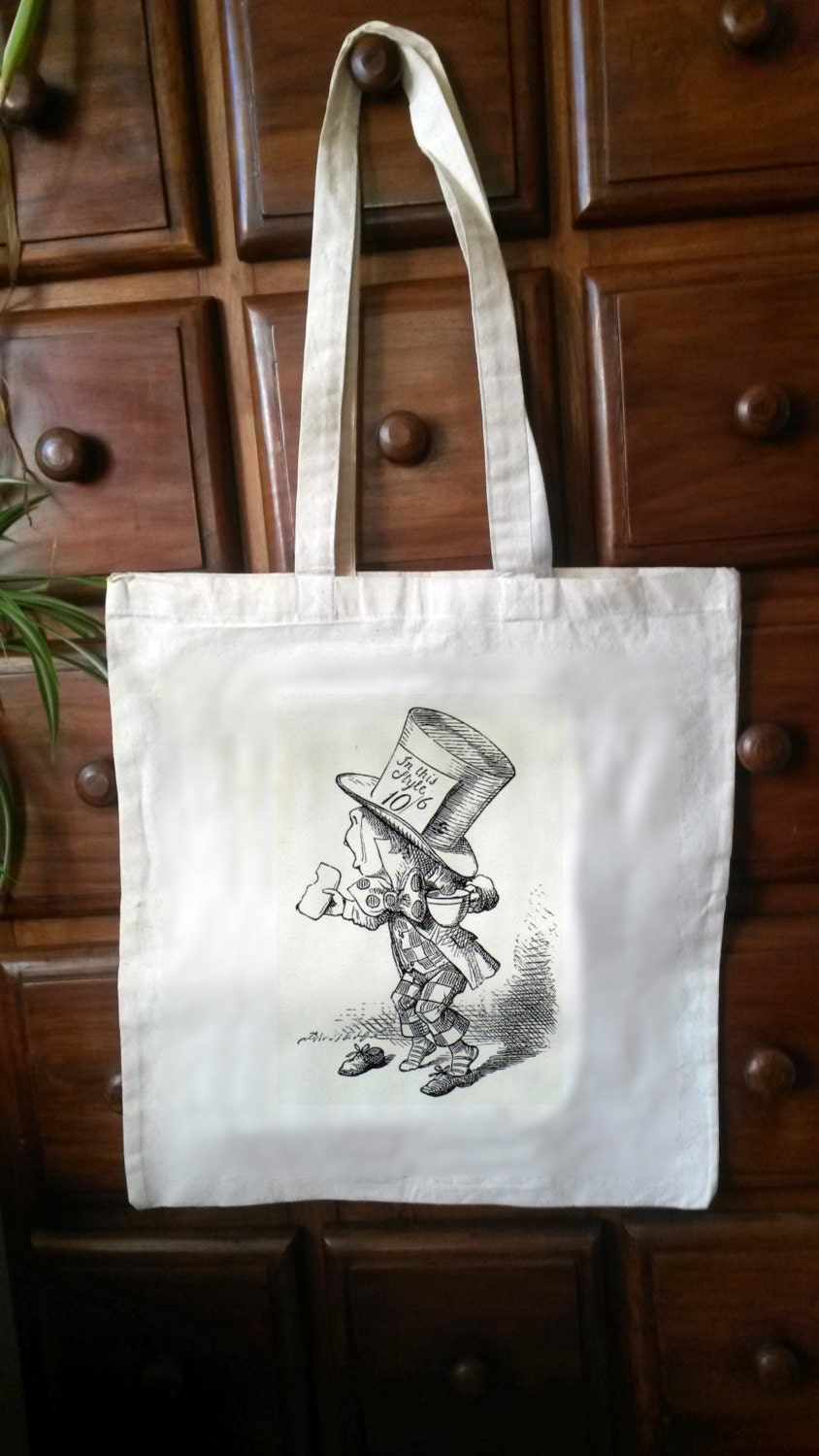 One CreamWhite Cotton Tote with an original illustration taken from the first edition of CS Lewiss Alice in Wonderland (Bag03)