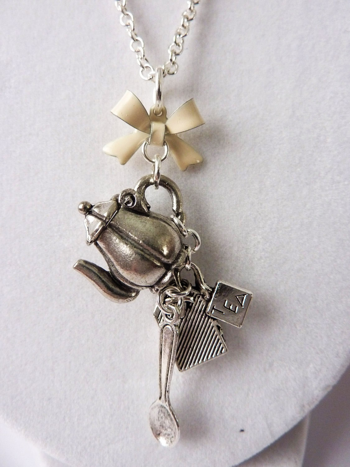 Tea Party Charm Necklace with Hinged Teapot, Tea Bag, Spoon, and Cream Bow - Cute Unique Tea Time Necklace by Weirdly Cute Jewelry - WeirdlyCute