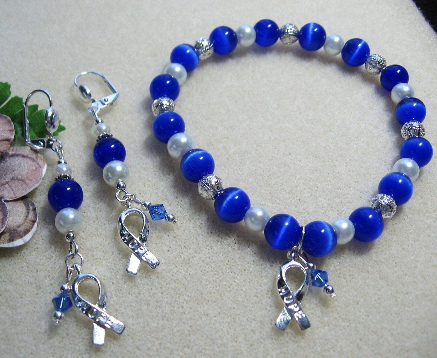 items similar to colon cancer awareness blue cats eye