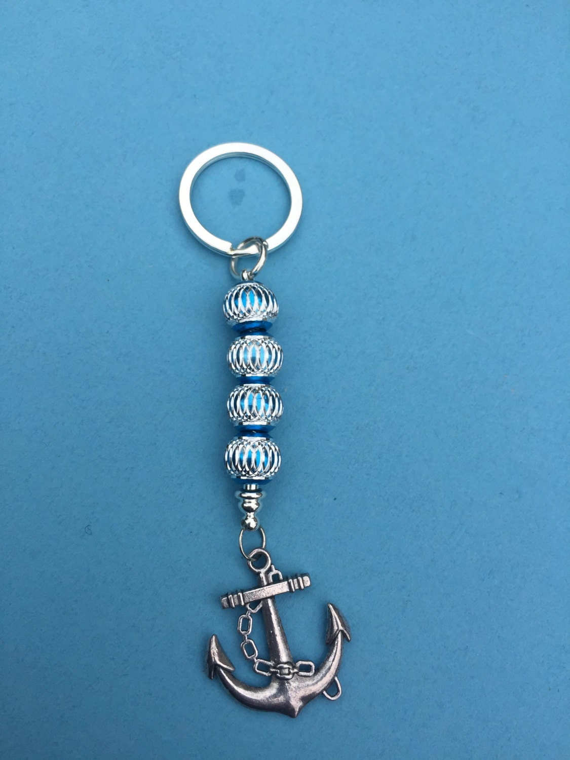 Anchor keyring silvertone Blue and silver look beads on a silvertone snake chain key ring