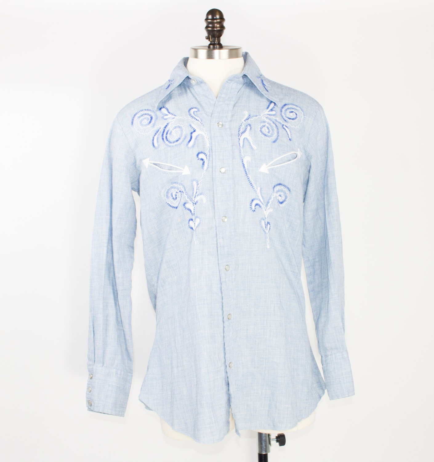 Pearl-Snap Shirts. A Texas twist on the button-up, the pearl-snap shirt has been a wardrobe staple among the cowboy (and cowgirl) set since the fifties. Stitched yokes and flap pockets give it.