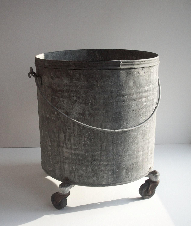 Vintage industrial galvanized metal bucket on wheels by for Old metal buckets
