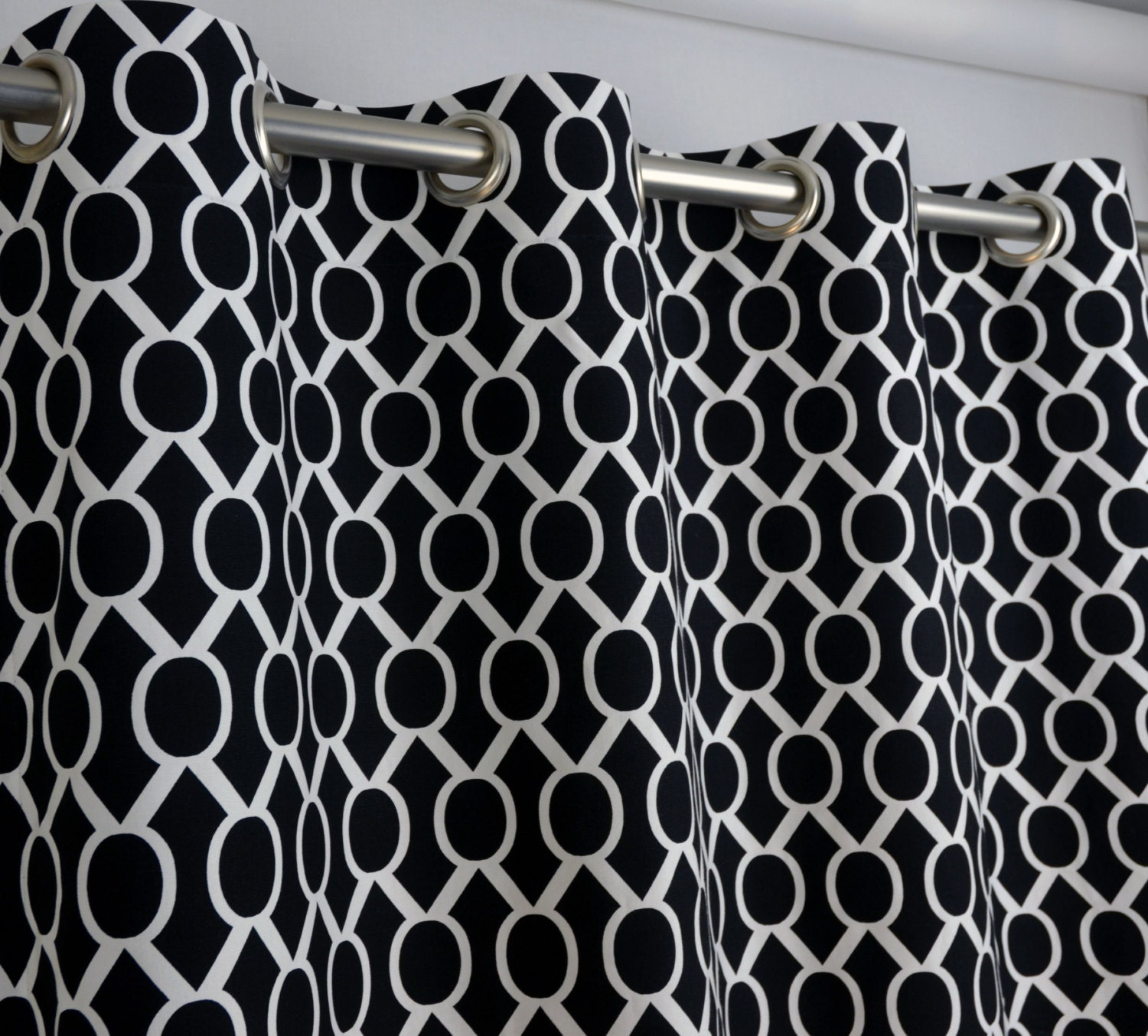 pair of grommet top curtains in black and white by zeldabelle