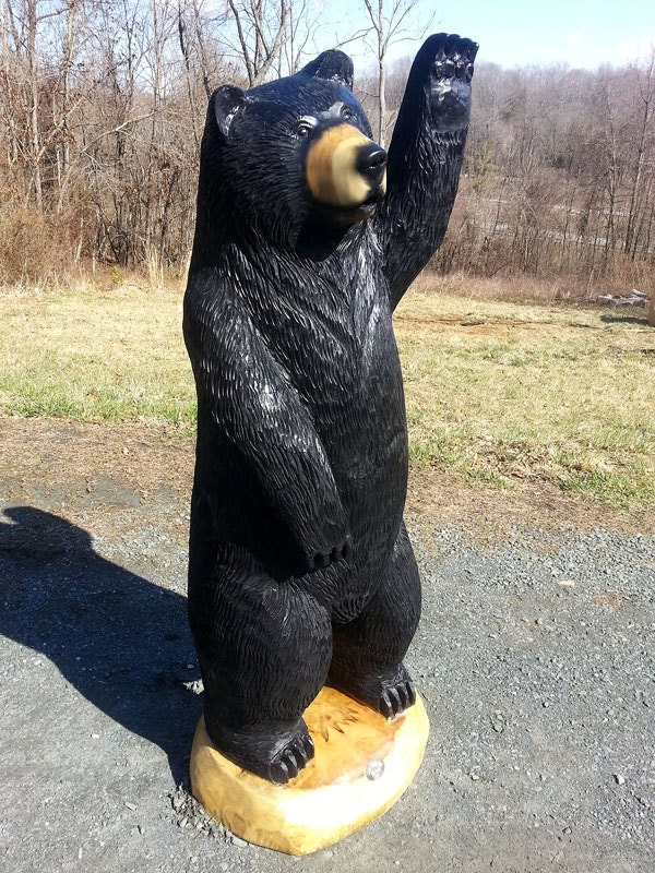 Chainsaw black bear wood sculpture waving by