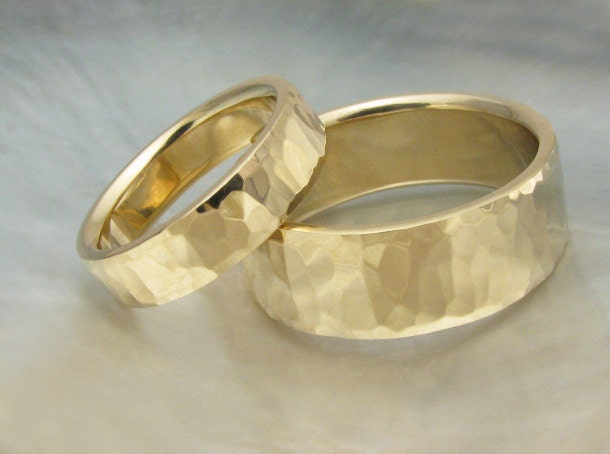 his and hers hammered gold bands for a touch of rustic charm rings and photograph by ravens refuge