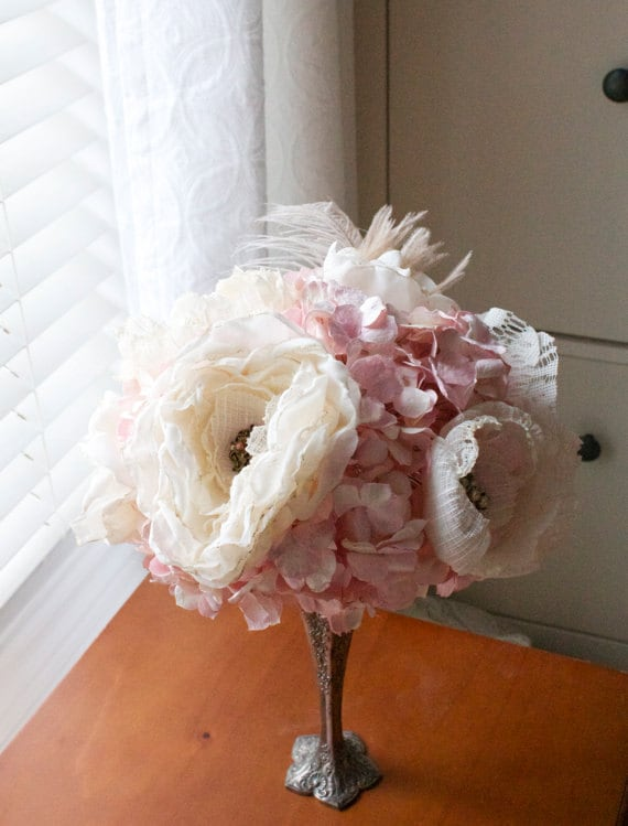 Soft fabric garden roses nestled into pale pink paper flowers, vintage broach centered flowers and ostrich feather bouquet - AlternativeBlooms