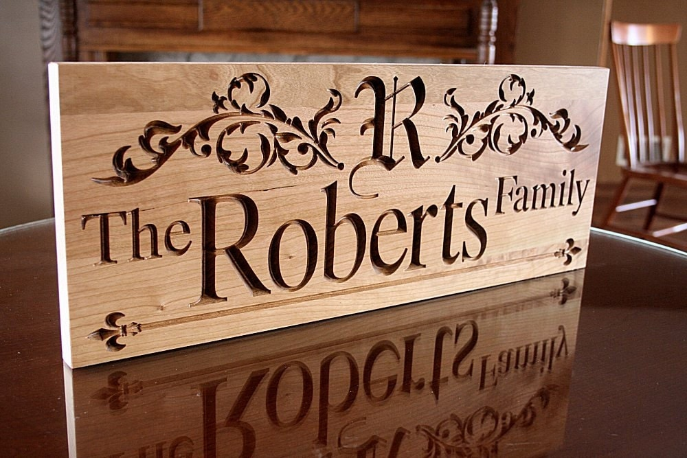 Carved wooden sign family name by benchmarkcustomsigns