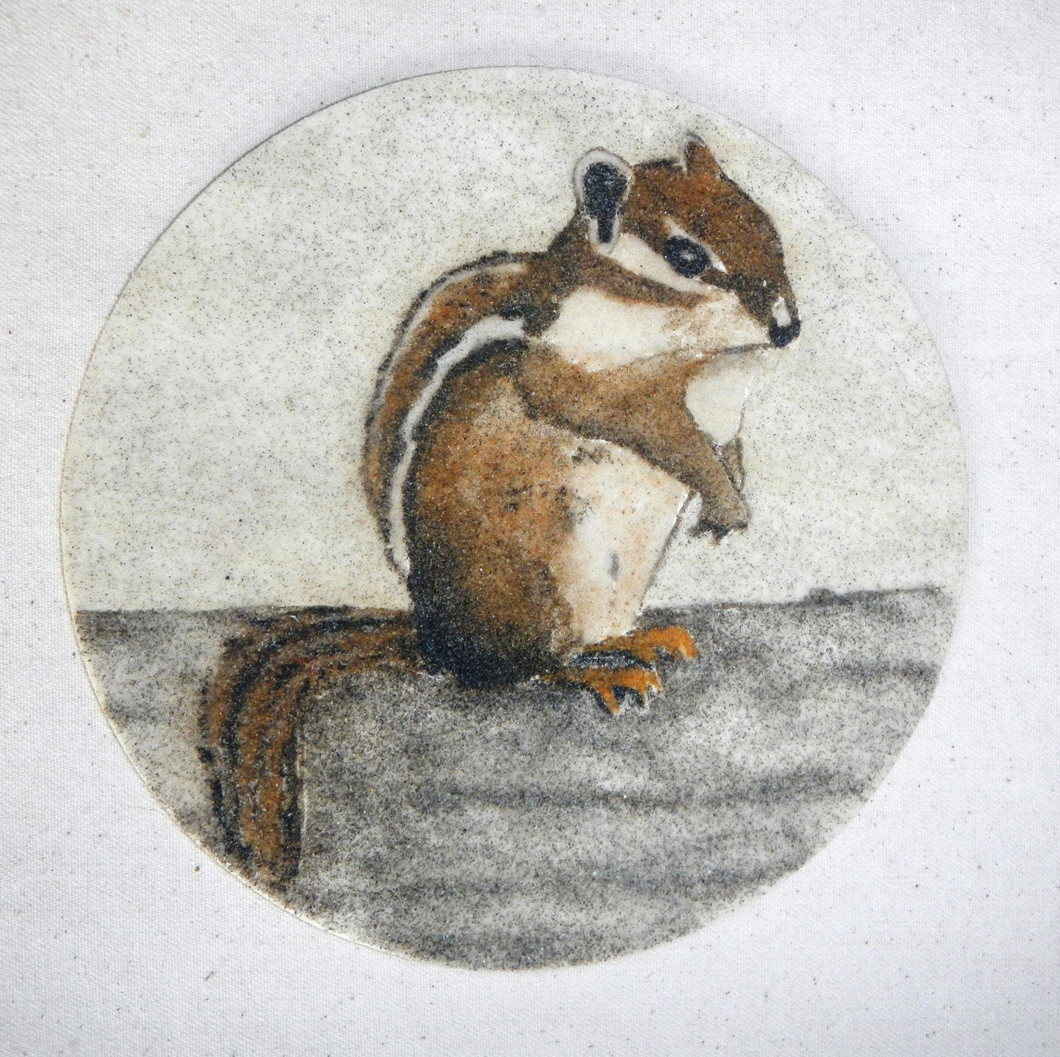 Striped Chipmunk circle sand painting original art work packaged in a colorful gauze bag