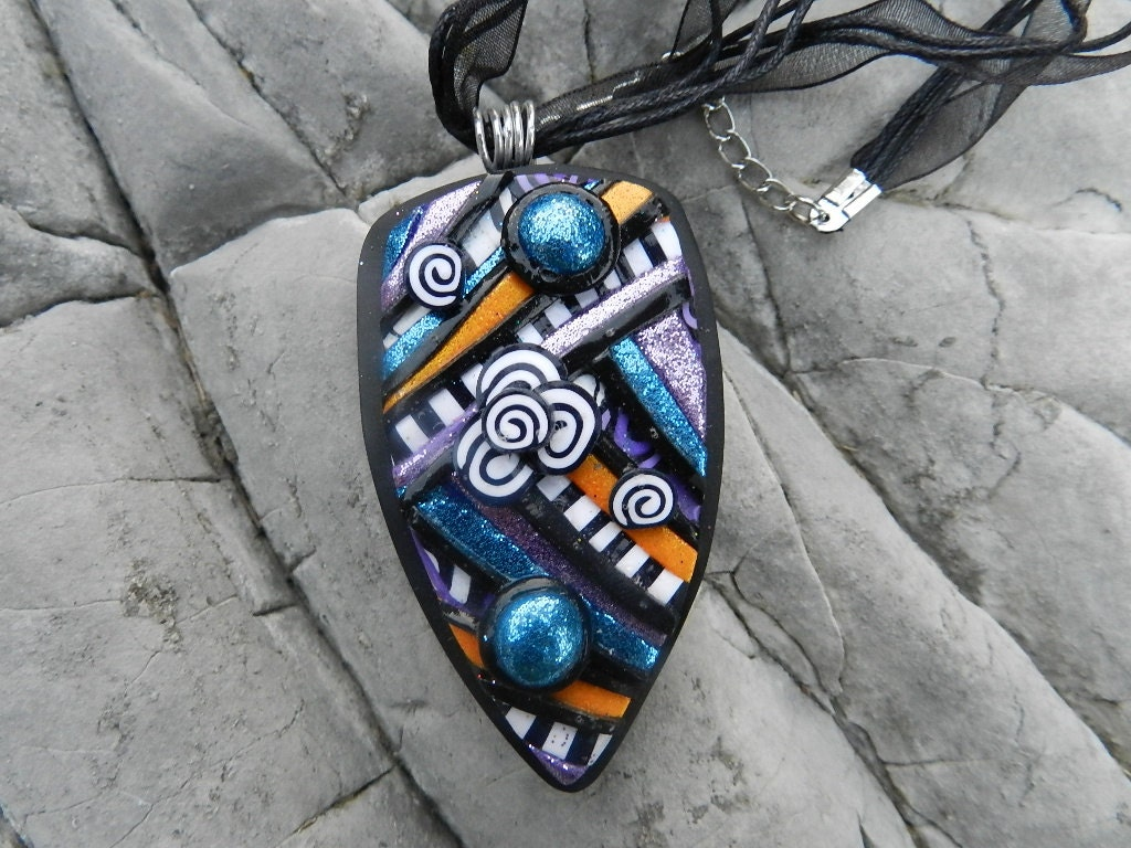 Polymer clay artisan abstract pendant handmade by Pook Desginz