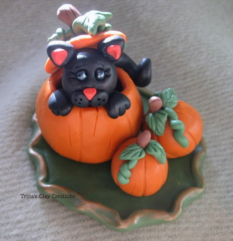 Polymer Clay Black Cat In A Pumpkin Patch - trinasclaycreations