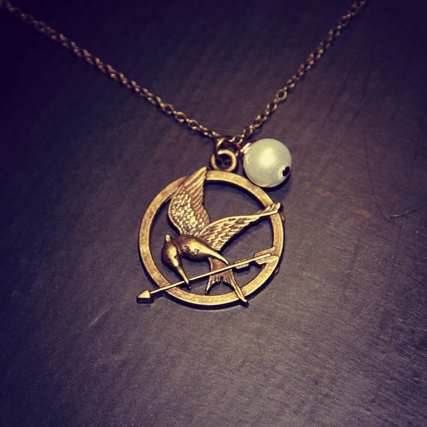 hunger mockingjay necklace with peeta s by deenaweasley
