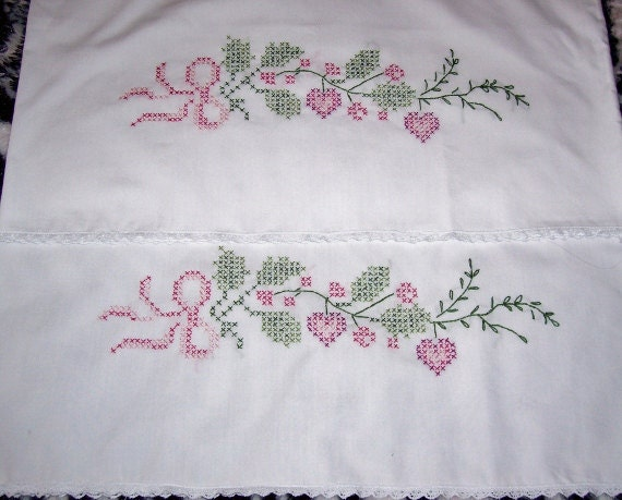 Hand embroidered floral pillow cases with lace edge by
