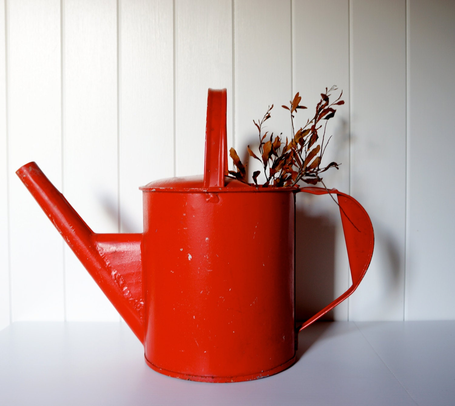 Vintage red watering can