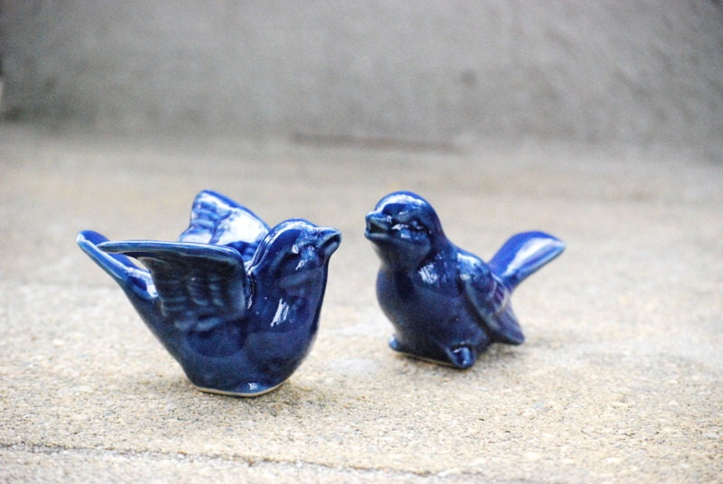 Monaco blue love birds wedding cake toppers in a courtship dance - claylicious