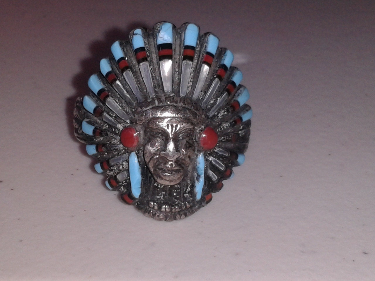 mens silver Geranimo ring with turquoise and mother of pearl inlay headdress
