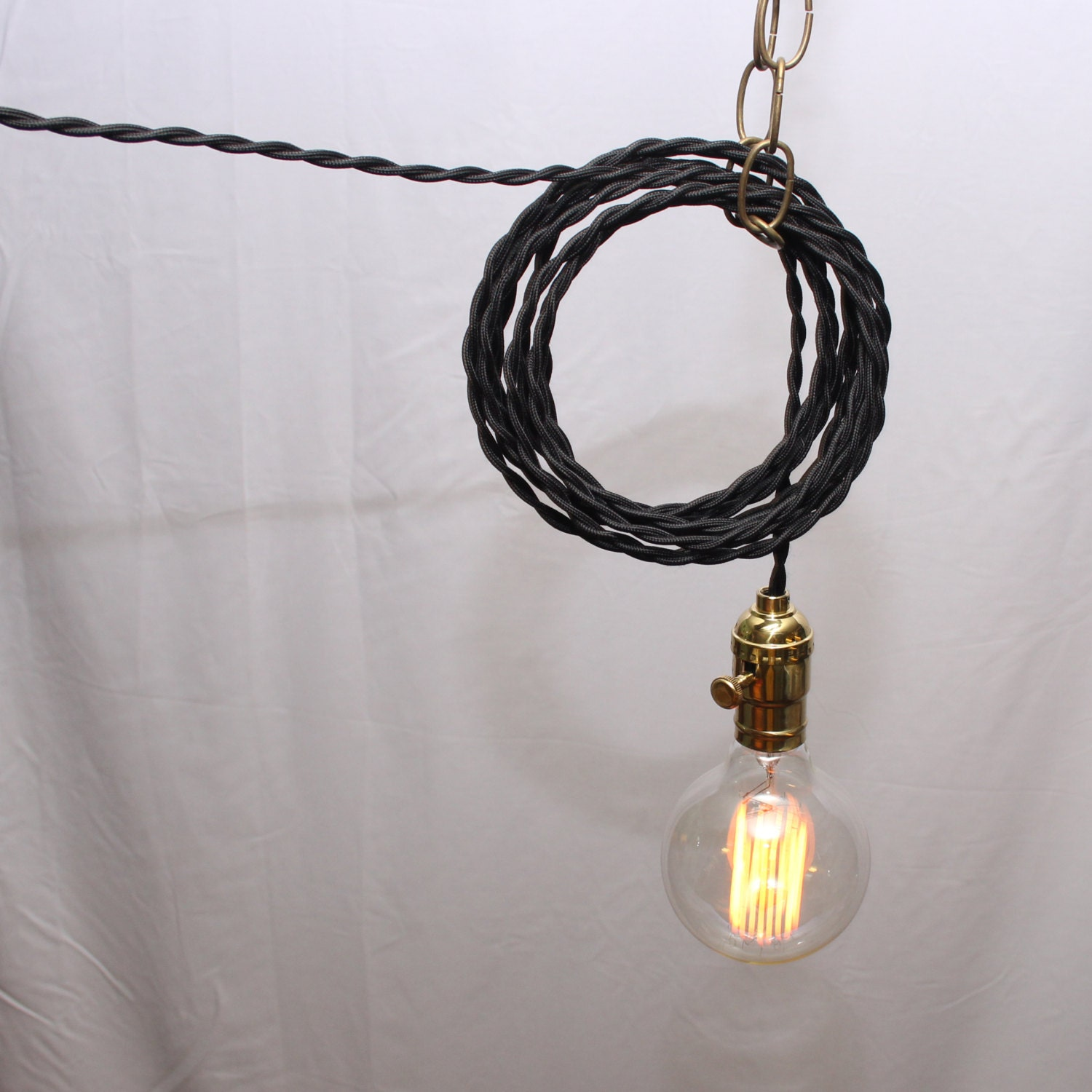 hanging lamp twisted black cord exposed edison bulb. Black Bedroom Furniture Sets. Home Design Ideas