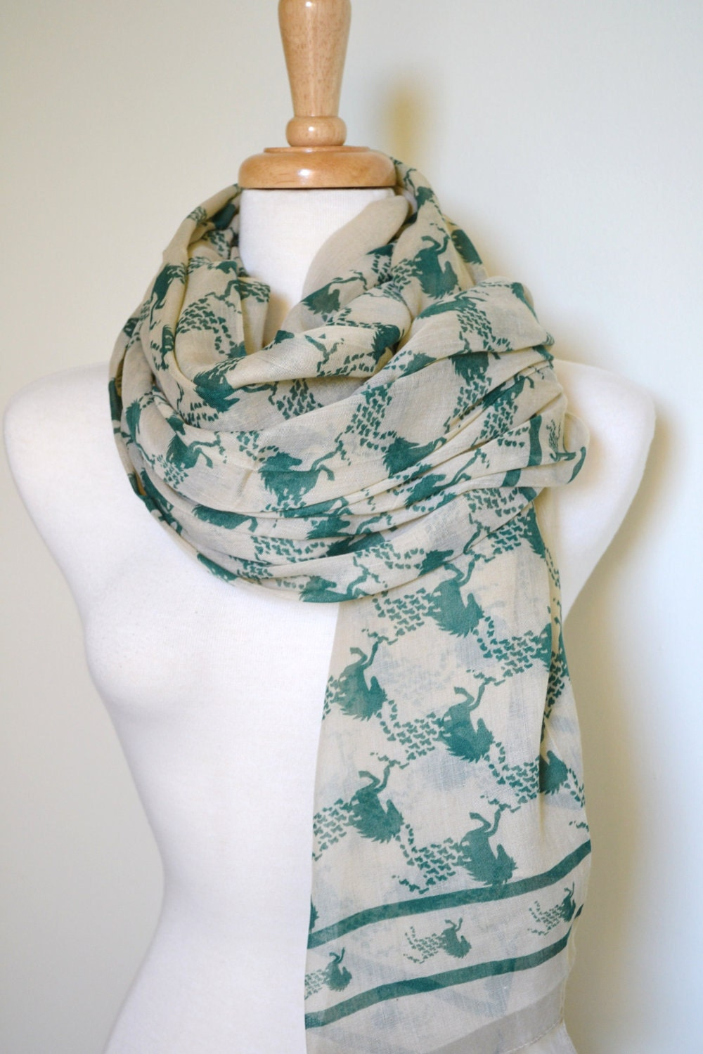 Scarf with images of green horses