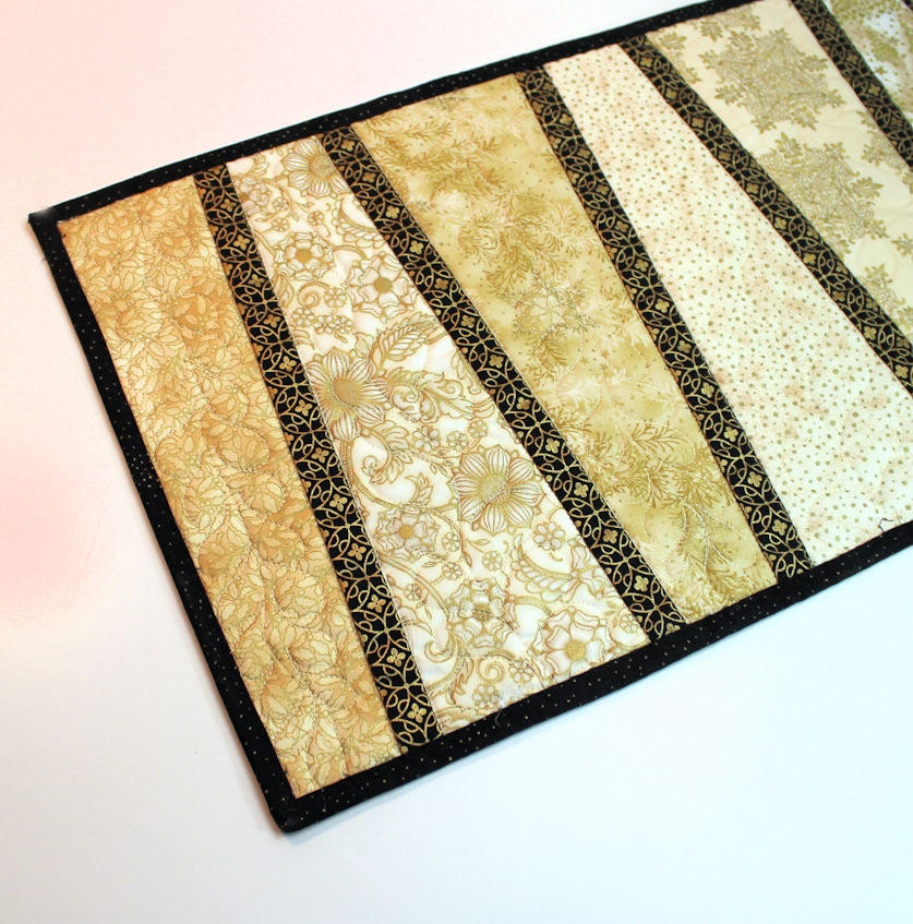 Elegant Table Runner Quilt in gold and black