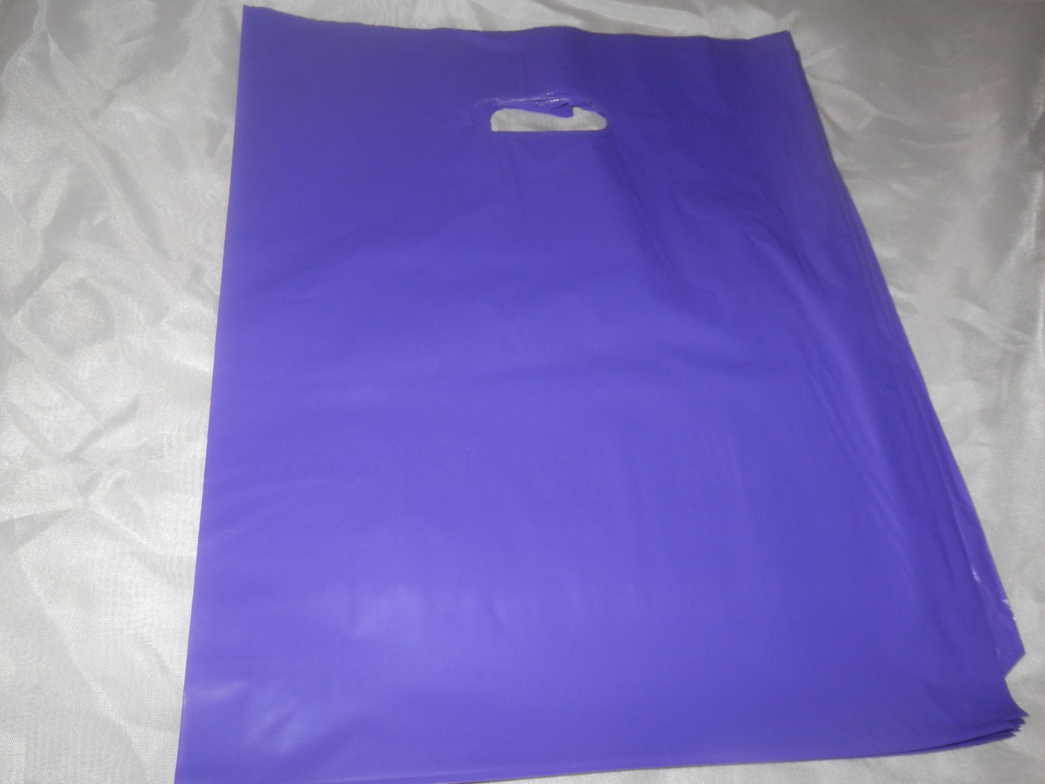 Purple Plastic Merchandise Bags size 12x15 Handle Retail Gift Bags ...