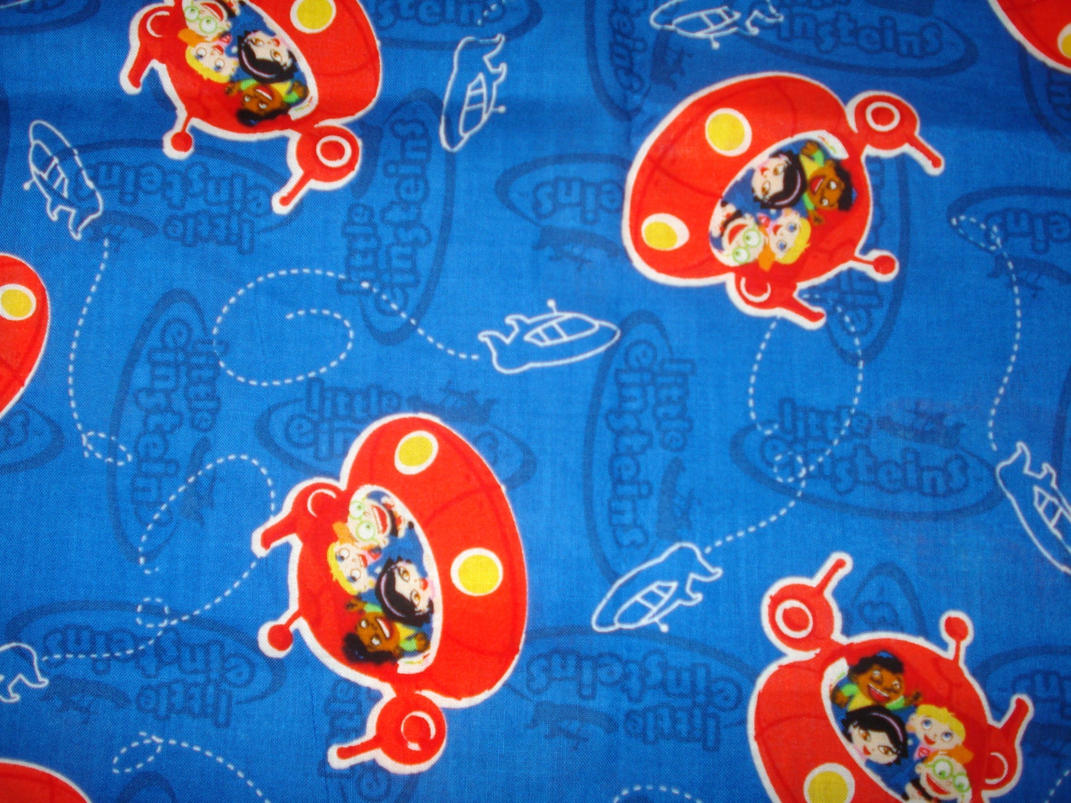 Half yard of little einsteins in rocket cotton by for Rocket fabric