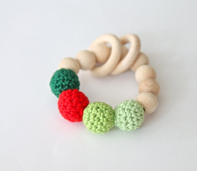 Red dot on shades of green. Teething ring toy with crochet wooden beads. Rattle for baby. - nihamaj