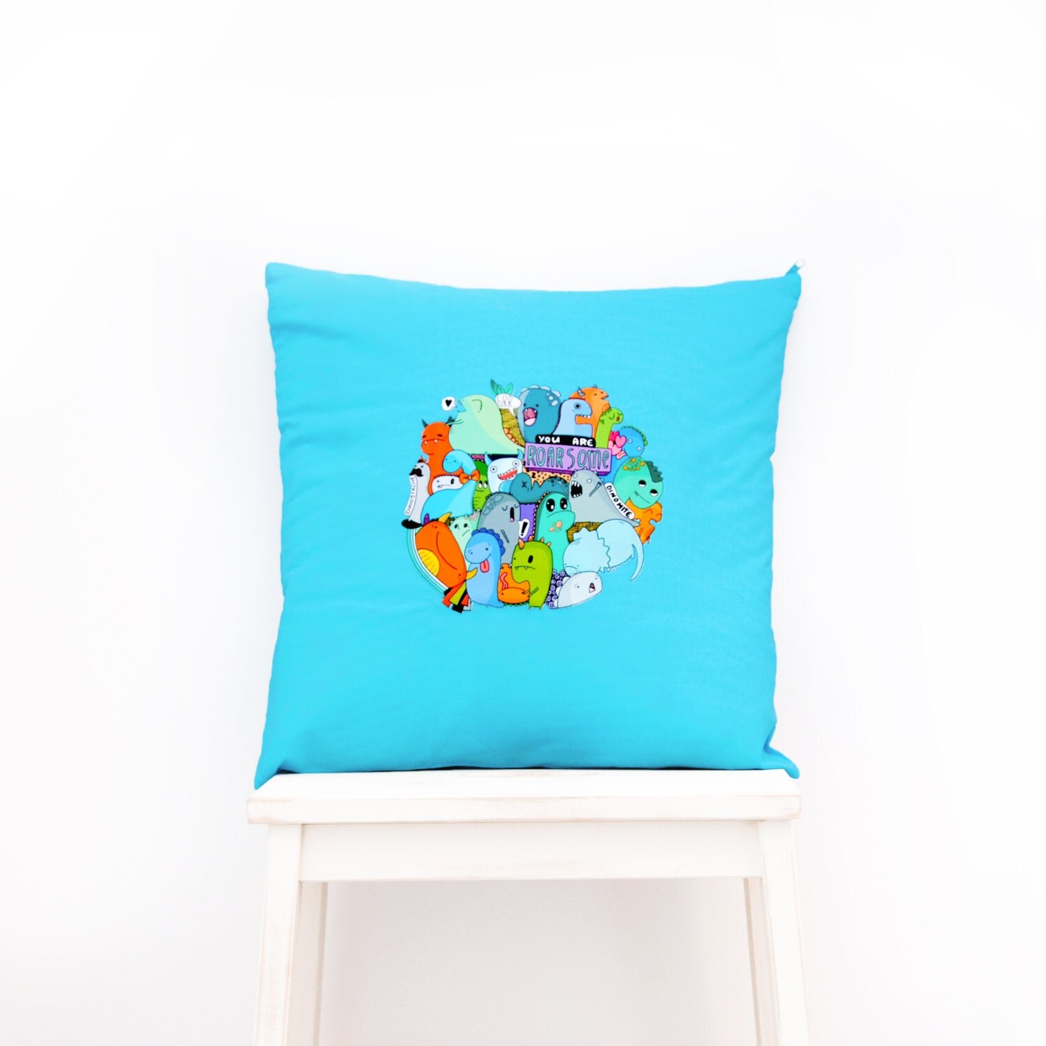 Roarsome  Kawaii Dinosaur Cushion home decor for childrens bedroom nursery or cosy accessories for the home. Blue w multi coloured hues