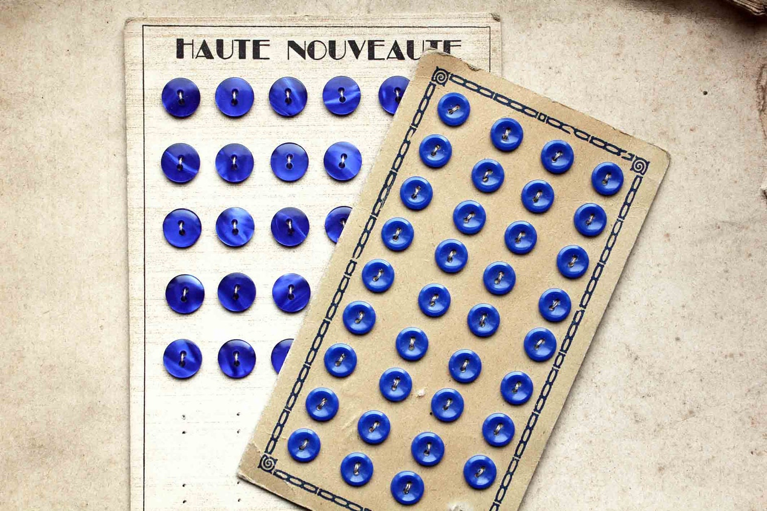 Sapphire blue buttons on cards
