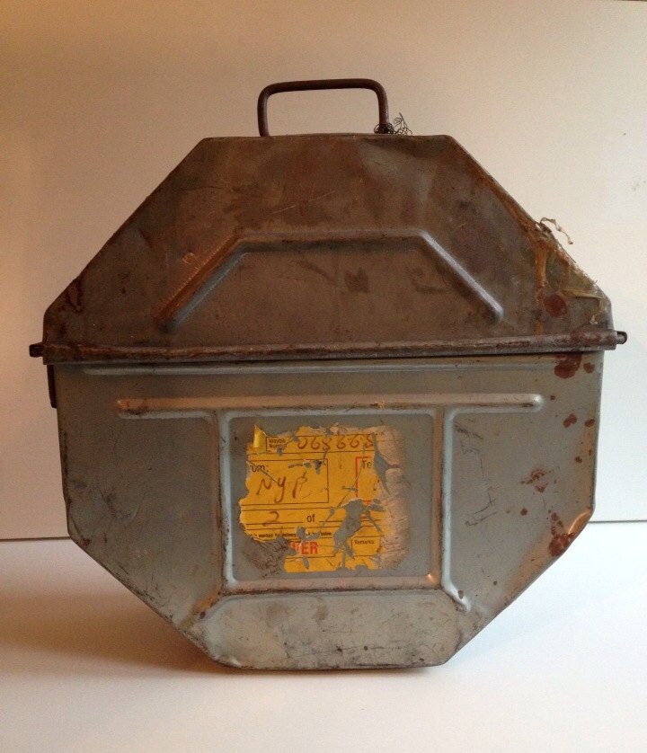 old movie reel case with 3 reels slot