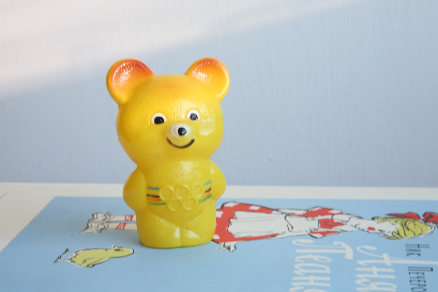 Vintage Russian Yellow Celluloid Moscow Olympic Games Mascot Bear Misha Rattle - TwoRedSuitcases