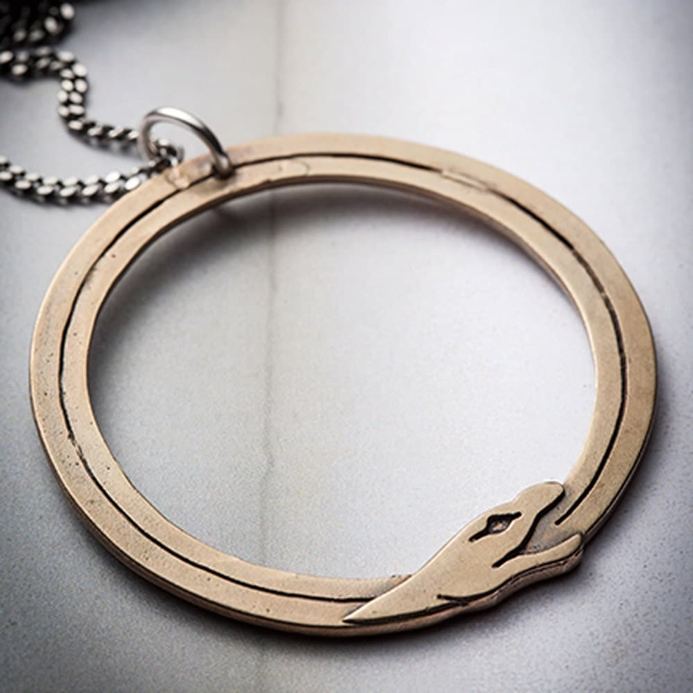 SERPENT- bronze ouroboros on a silver chain - missyindustry