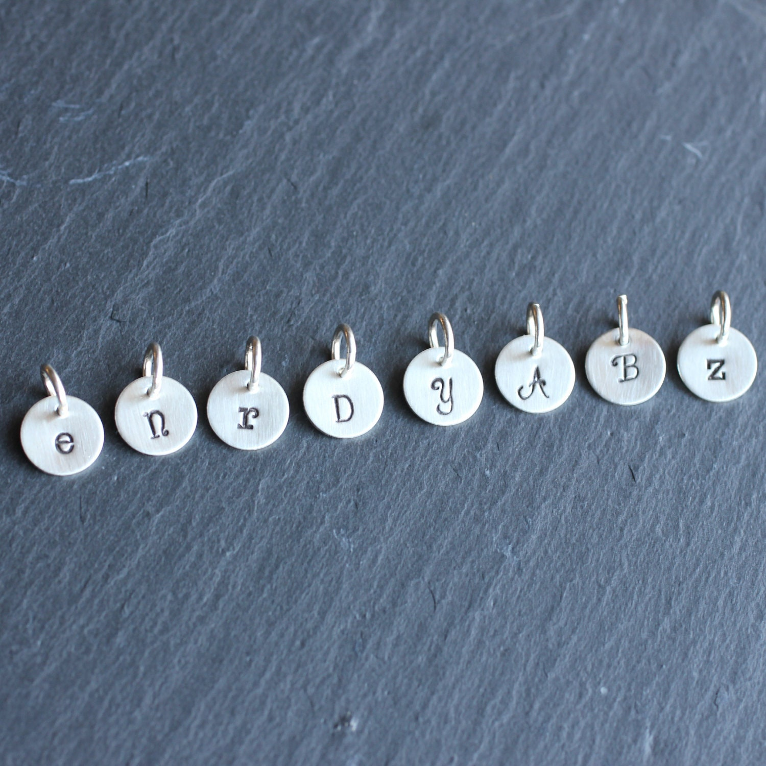 tiny initial charms hand stamped letter or by annaourthjewelry With stamped letter charms