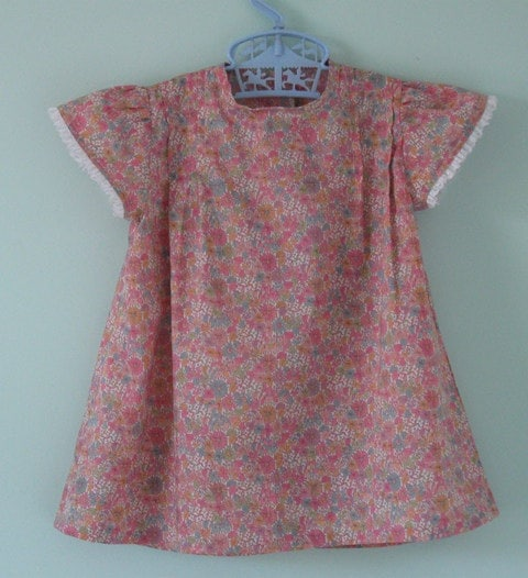 Pretty liberty lawn baby dress. Age 6 months.  Ideal colours for Fall.